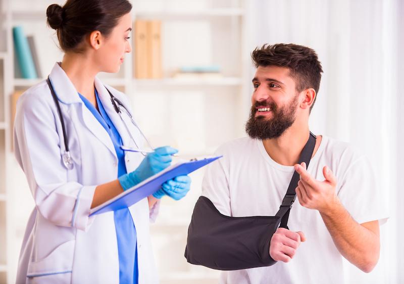 saddleback urgent care doctor treating man for sprains or broken bones